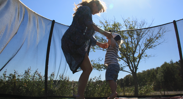 Children jumping on the trampoline-Photo